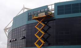 Men in cherry picker fixing black Louvres